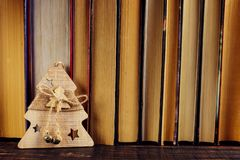 Standing on the bookshelf, Christmas tree decoration. Place for text, copy space stock photos