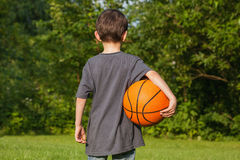 Standing boy with ball Stock Photography