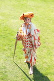 Standing boy with sword. Little boy in landsknecht clothes with sword standing on green grass Stock Image