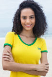 Standing brazilian sports fan with curly hair and crossed arms Stock Photography