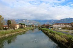 Standing on a bridge in Marina di Massa in Italy. Standing on a bridge in Marina di Massa in Italy with a view to the mountains. Creare blu Sky royalty free stock photography