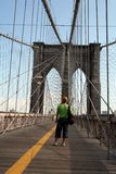 Standing on the Brooklyn Bridge. Women Standing on the Brooklyn Bridge Royalty Free Stock Photos