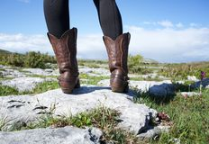 Standing in brown leather boots Royalty Free Stock Photos