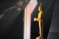 Standing Budda at Wat Doi Saket. The temple at Doi Saket is similar to the Doi Suthep Temple, yet smaller in size. The entrance to the temple (as is the case at Royalty Free Stock Images