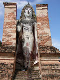 Standing Buddha. Thai Temple with a standing Buddha stock photography