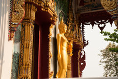 Standing Buddha front of Church on Thai temple in Thailand. Stock Photo