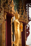 Standing Buddha front of Church on Thai temple in Thailand. Stock Photos