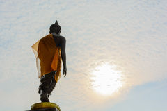 Standing Buddha image with sky. In Thailand Stock Image