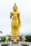 STANDING BUDDHA. The most respected Buddha image in Hat Yai is Phra Buddha Mongkol Maharaj. This Standing Buddha, on a hilltop in the municipal park, is 19.90 Stock Photography