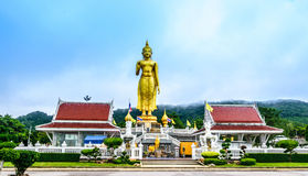 STANDING BUDDHA. The most respected Buddha image in Hat Yai is Phra Buddha Mongkol Maharaj. This Standing Buddha, on a hilltop in the municipal park, is 19.90 Stock Photo
