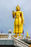 STANDING BUDDHA. The most respected Buddha image in Hat Yai is Phra Buddha Mongkol Maharaj. This Standing Buddha, on a hilltop in the municipal park, is 19.90 Stock Photos