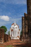 Standing Buddha. Statue with blue sky Stock Photos