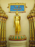 Standing Buddha statue in Buddhist temple Stock Photo