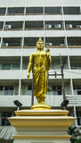 The standing buddha statue. In front of building downtown in Thailand Royalty Free Stock Photography