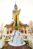 Standing buddha statue front of church. Of Wat Phra That Doi Gongmoo in Maehongson under white cloudy sky Stock Photos