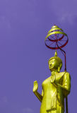 Standing Buddha Statue. Standing golden buddha statue and blue sky Royalty Free Stock Photography