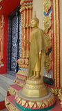 Standing Buddha  statue infront of the Buddhist chapel Stock Images