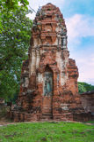 Standing Buddha statue inside ruined pagoda at Ayuttha Historica Stock Photos