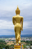 The standing Buddha statute in Thailand Stock Images