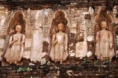 Standing Buddha on stupa. Standing Buddha on chedi 'Suwan Chang Kot' of Wat Ku Kut (Wat Jam Thewee), Lamphun Thailand Royalty Free Stock Photo
