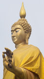 Standing buddha with withered flower on the left hand. Standing buddha with withered flowers on the left hand Stock Photo