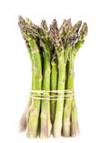 Standing bunch of green asparagus  vegetables isolated on white Royalty Free Stock Photos