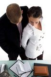 Standing business couple looking diary Royalty Free Stock Photo