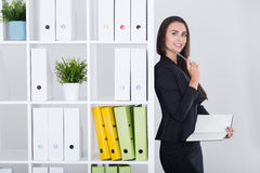Standing business lady writing her thoughts down Royalty Free Stock Image