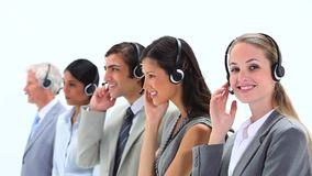 Standing business people speaking into headset Royalty Free Stock Photography