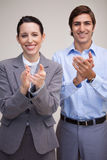 Standing business team applauding Royalty Free Stock Photos