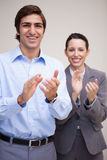 Standing business team clapping Stock Photos
