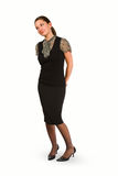 Standing business woman. Business woman standing with sideways glance Royalty Free Stock Photography