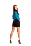 Standing business woman backside view turned to camera Royalty Free Stock Image