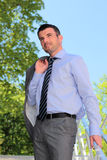 Standing businessman Stock Images