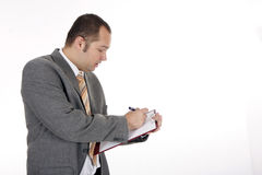 Standing businessman with clipboard Royalty Free Stock Images