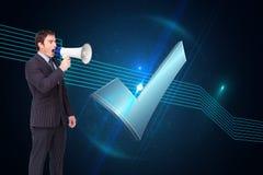 Standing businessman shouting through a megaphone Stock Photos
