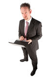 Standing Businessman Using Computer Royalty Free Stock Photos