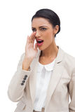 Standing businesswoman calling for someone Stock Images