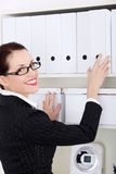 Standing businesswoman holding file binder. Royalty Free Stock Photo