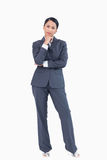 Standing businesswoman in thoughts Royalty Free Stock Images
