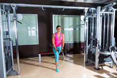 Standing Cable Crossover Fly flies woman workout. Standing cable crossover fly pulley flies woman workout at gym stock photography