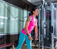 Standing Cable Crossover Fly flies woman workout. Standing cable crossover fly pulley flies woman workout at gym royalty free stock photo