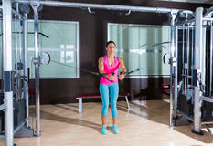 Standing cable crossover fly pulley flies woman. Workout at gym stock images
