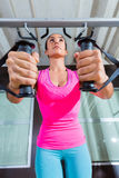 Standing cable crossover fly pulley flies woman. Workout at gym royalty free stock photo
