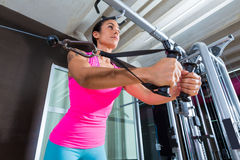 Standing cable crossover fly pulley flies woman. Workout at gym stock photo