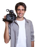 Standing cameraman waiting for action Royalty Free Stock Photography