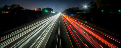 Standing in car on side of the road at night. In the city royalty free stock image