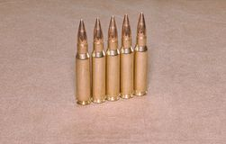 The standing cartriges 308 Winchester caliber with full metal jacket bullets steel case. Standing cartriges 308 Winchester caliber with full metal jacket bullets Stock Photos