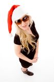 Standing christmas female with sunglasses Royalty Free Stock Photography