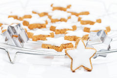 Standing cinnamon star in front of a cooling grid with cinnamon Stock Photos